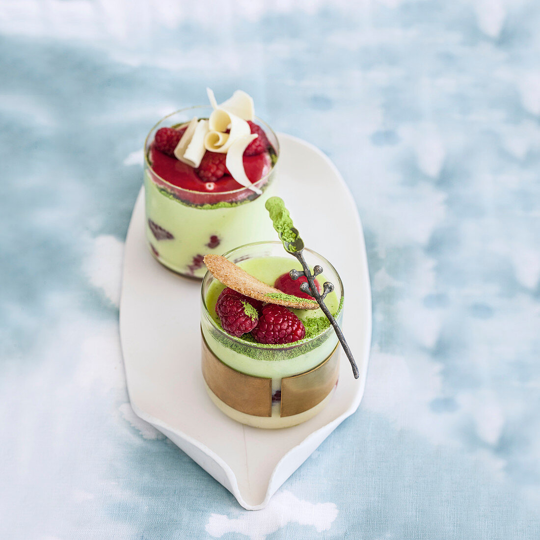 Matcha tea mousse with white chocolate and raspberries