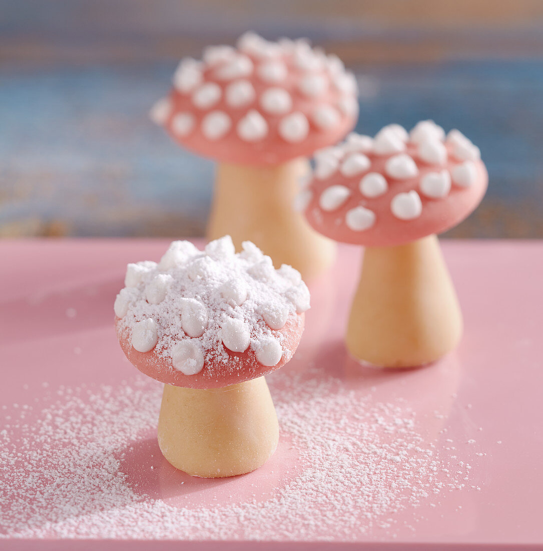 Mini toadstools made of marzipan with icing sugar