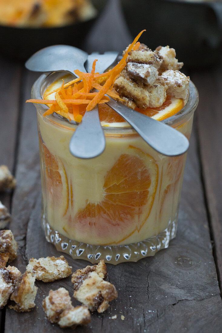 Orange pudding with orange peel and cinnamon bread chunks
