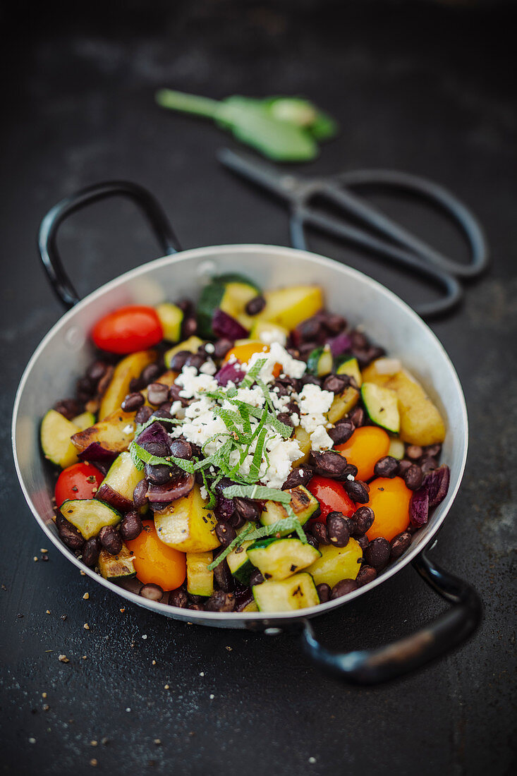Sauteed Vegetables with black beans in a pan