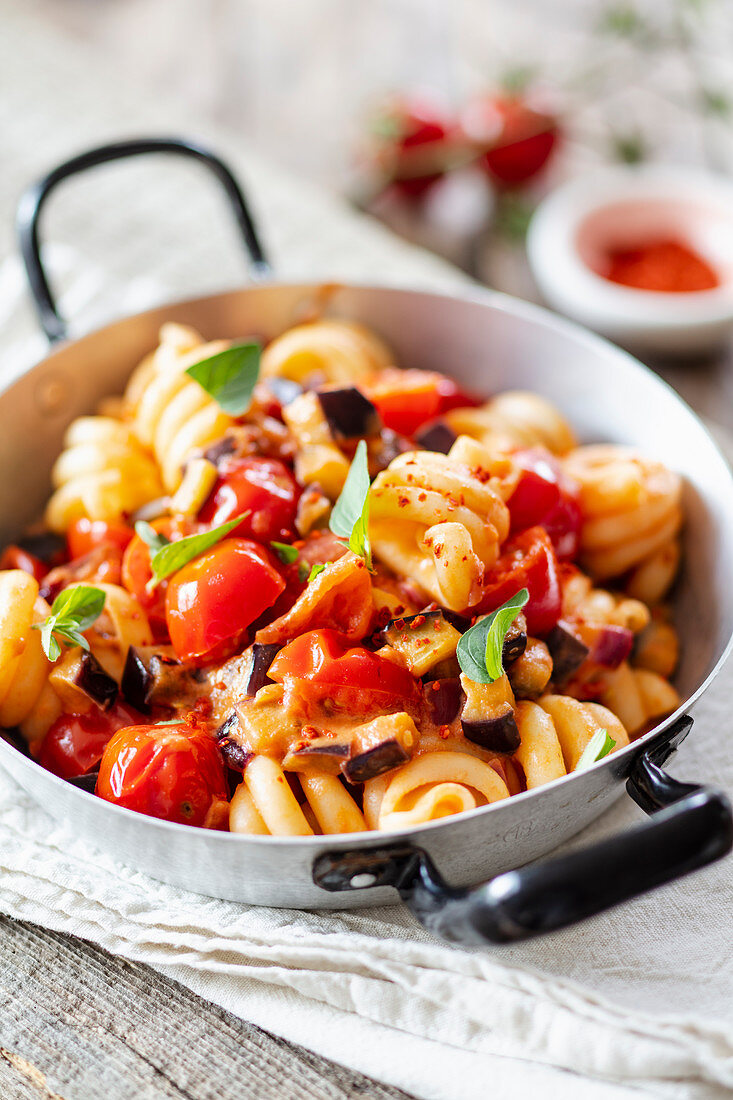 Fusilli with tomato and eggplant in a pan