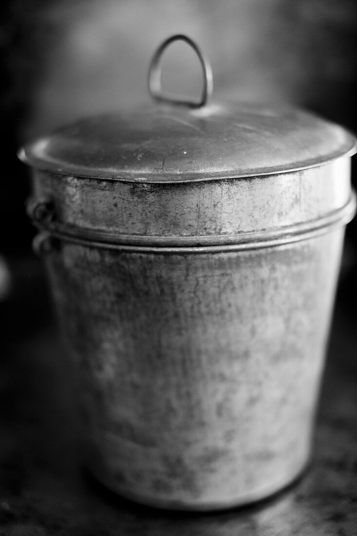An antique bead tin