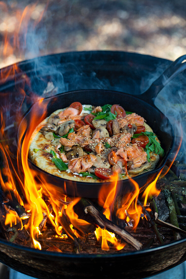 Grilled pan pizza with salmon