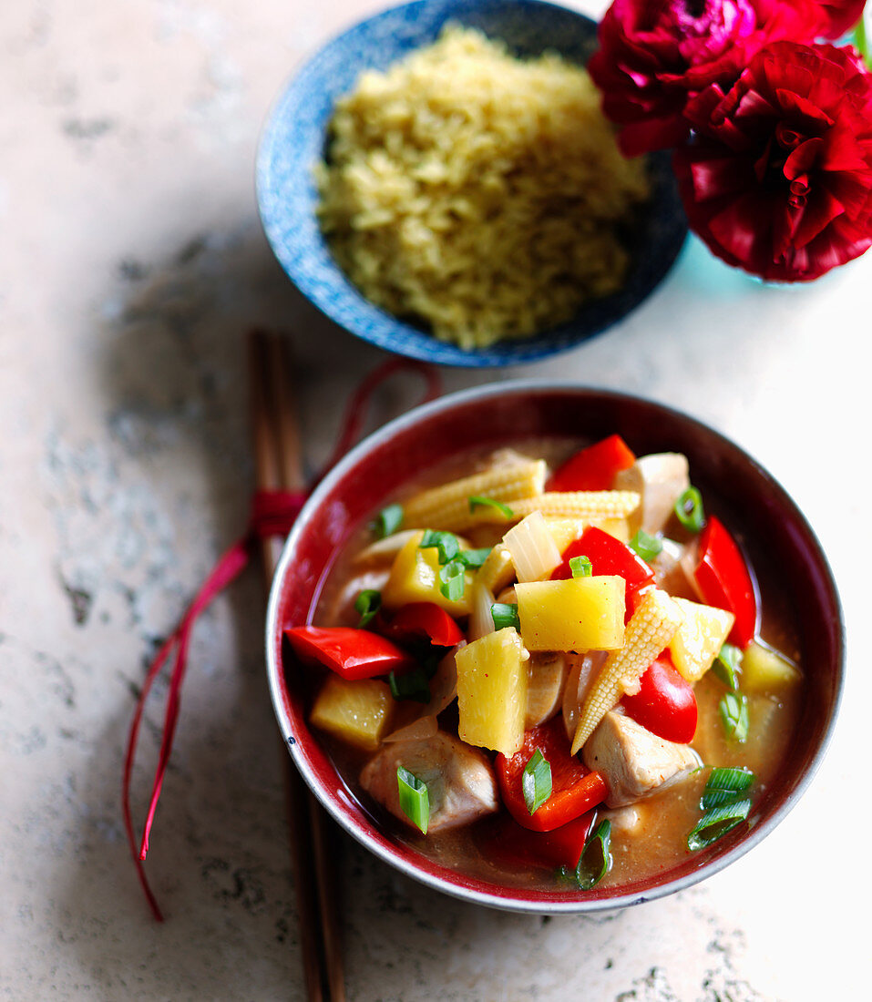 Cantonese chicken with pineapple, red peppers, spring onions and corncobs