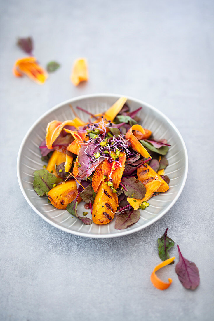 Lily flower salad with grilled apricots and a hibiscus and chilli dressing