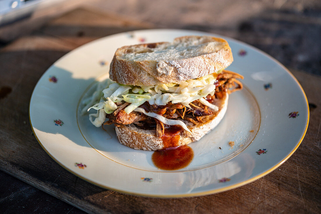 A pulled pork and coleslaw sandwich