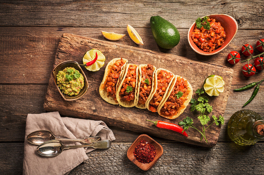 Mexican tacos with ground beef, beans and salsa