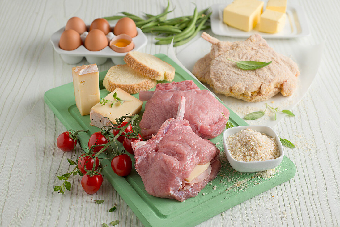 Ingredients for making stuffed and breaded pork chops