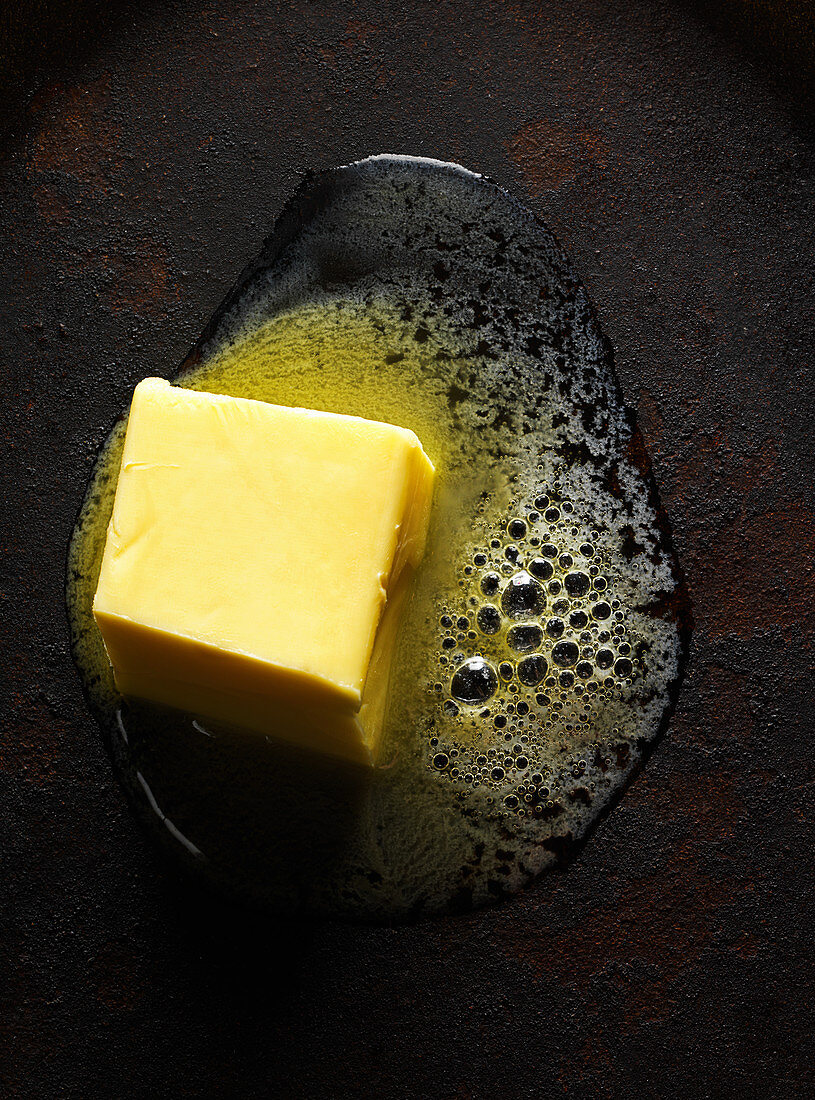 Pat of butter melting on cast iron