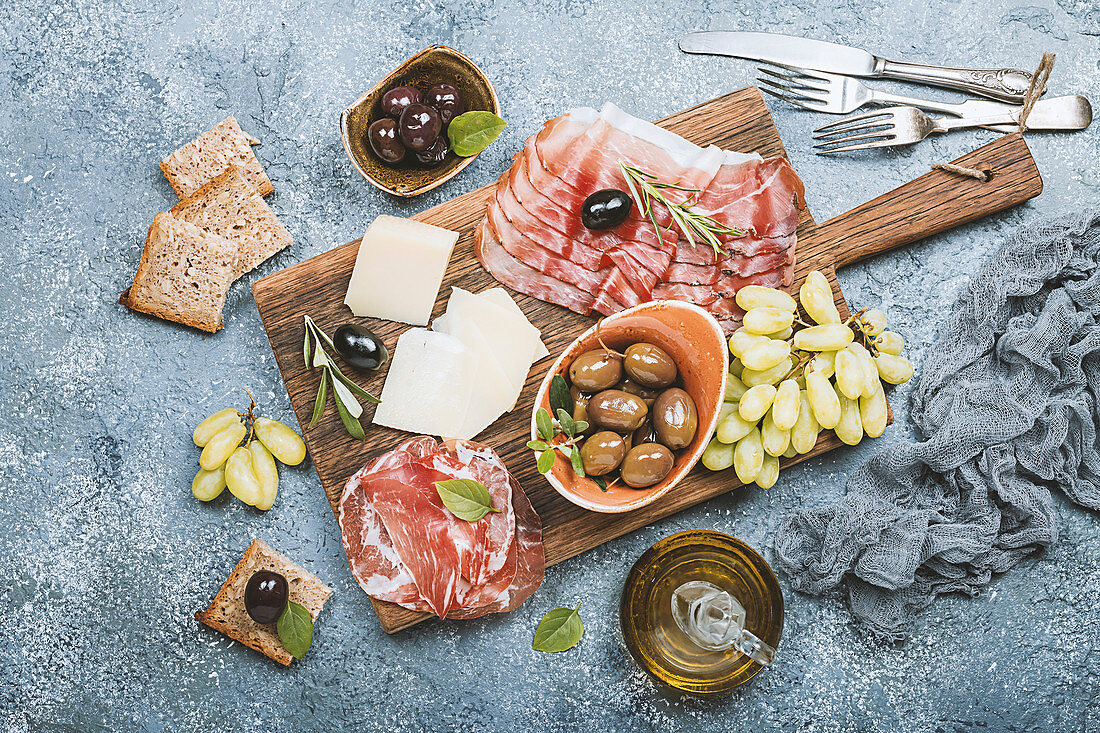 Typical italian antipasto - prosciutto, ham, cheese and olives