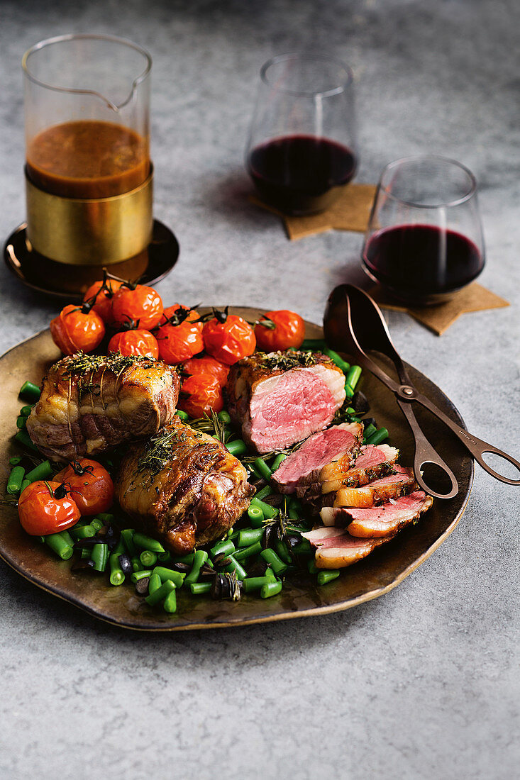 Rare lamb rump steaks with vegetables