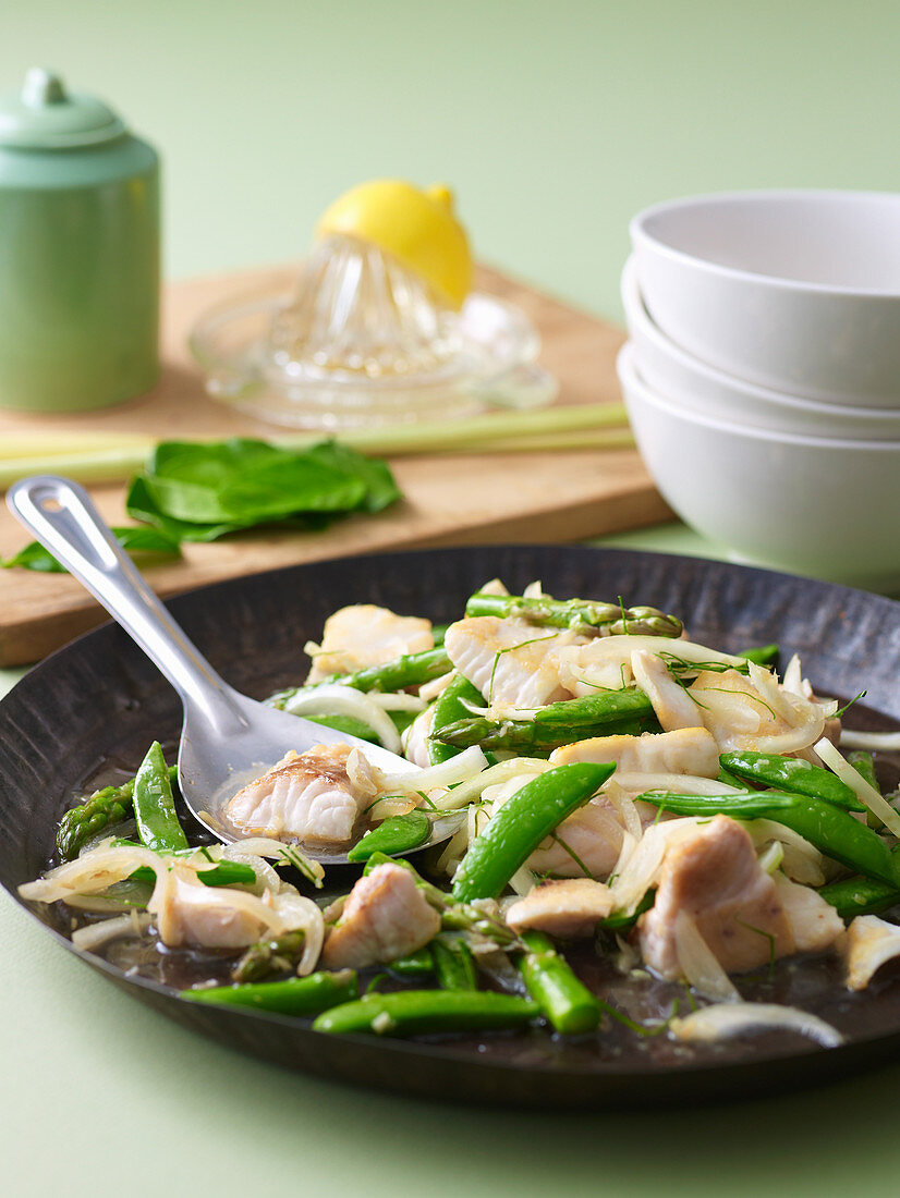 Stir-fried fish with kaffir lime and sugar snap peas