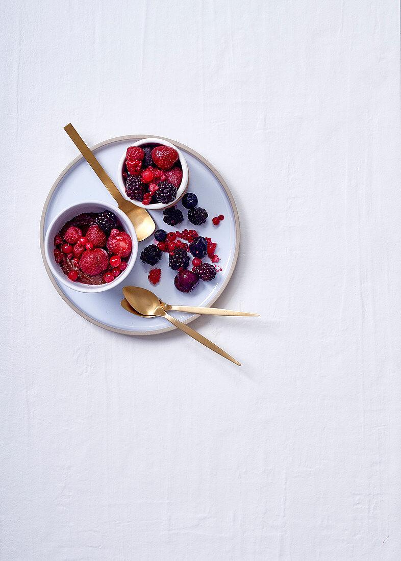 Macadamia, chocolate, vanilla pots with mixed frozen berries