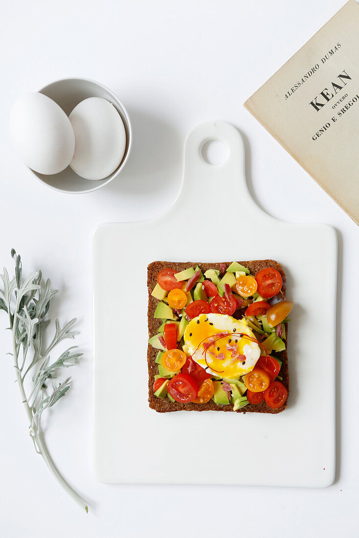 Avocado toast with cherry tomatoes and black seed