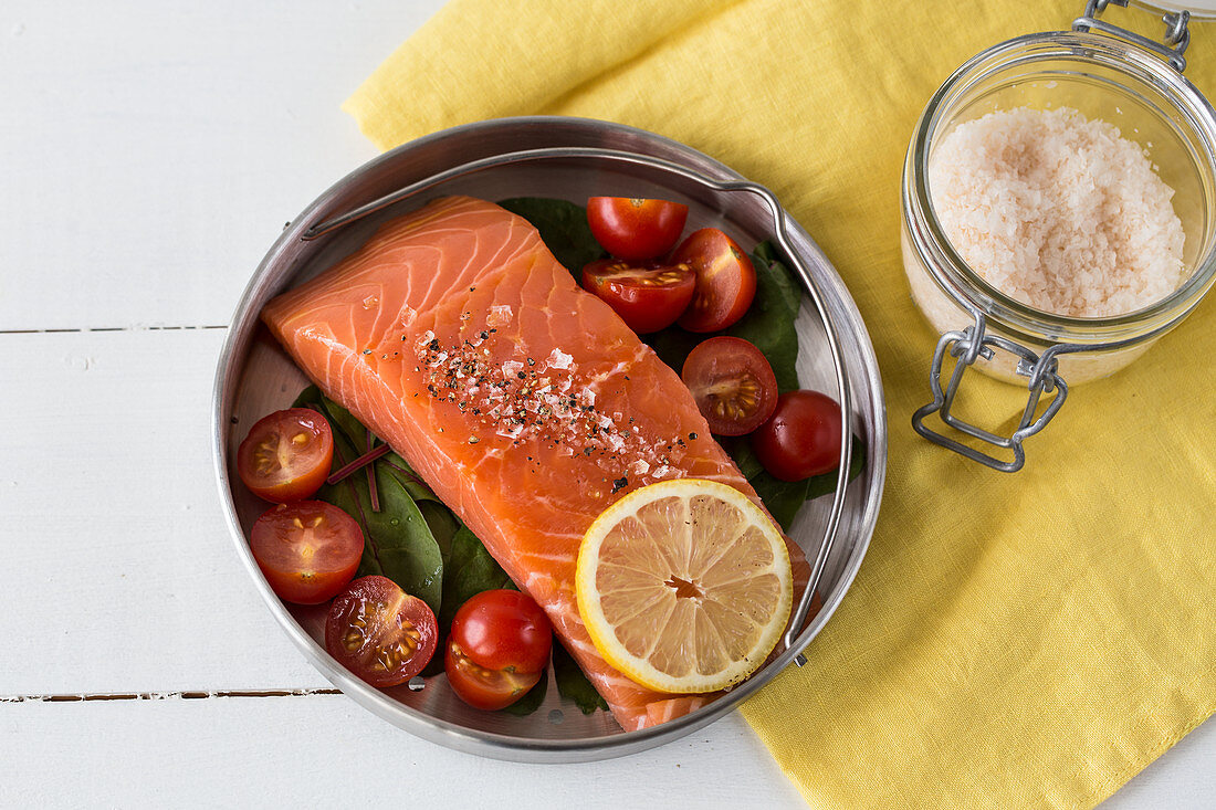 Salmon and tomatoes in a pressure cooker