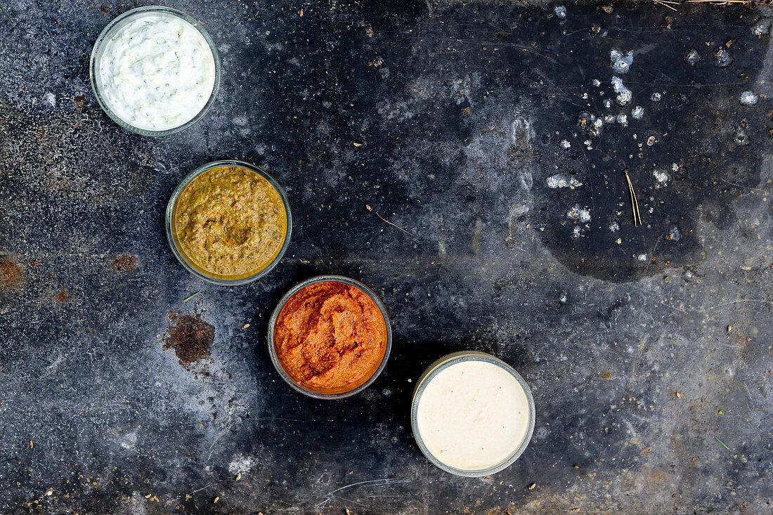Different dips. From left to right:Yoghurt-cucumber sauce, kik-bean-yoghurt sauce, romesco-sauce and remoulade-sauce