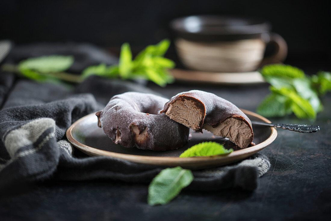 Vegan chocolate mint icecream donuts with dark chocolate icing