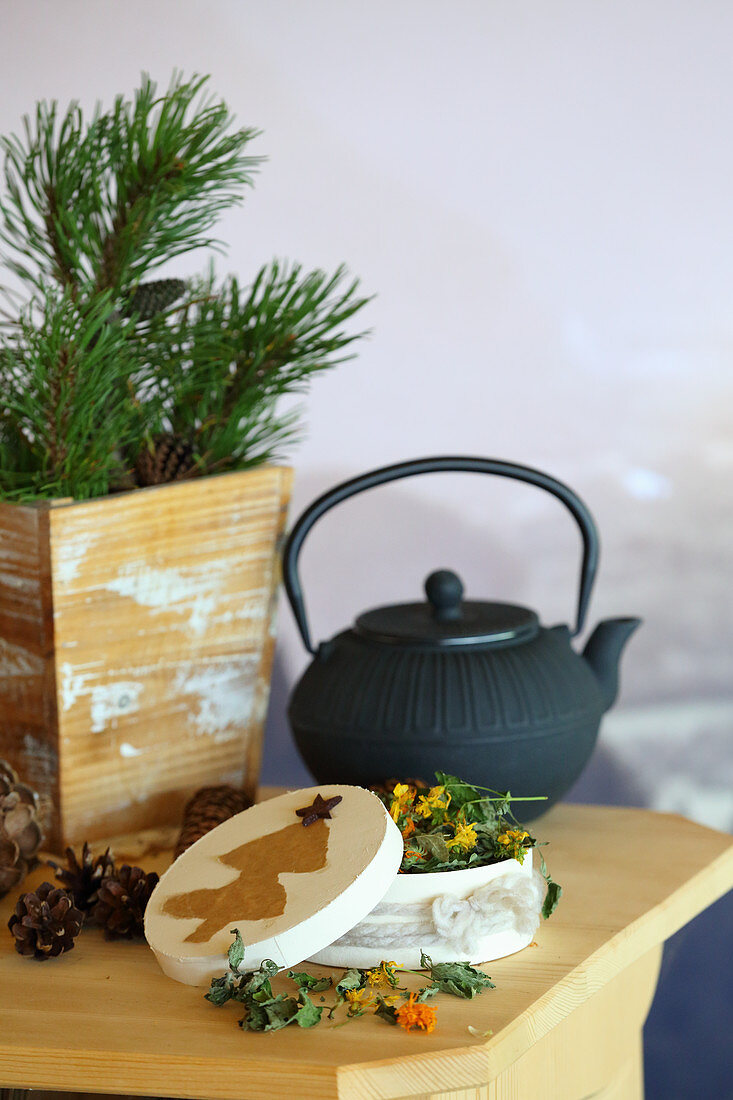 Gift of homemade tea in chip wood box with paper tree on lid