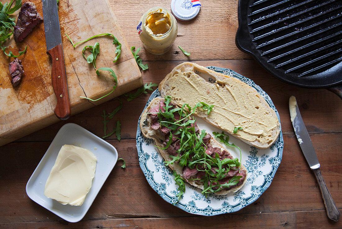 Steak sandwich on sourdough with mustard