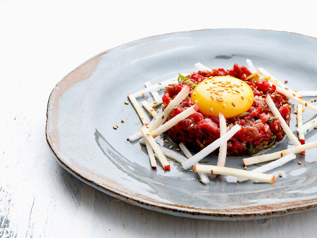 Tartare with raw egg yolk