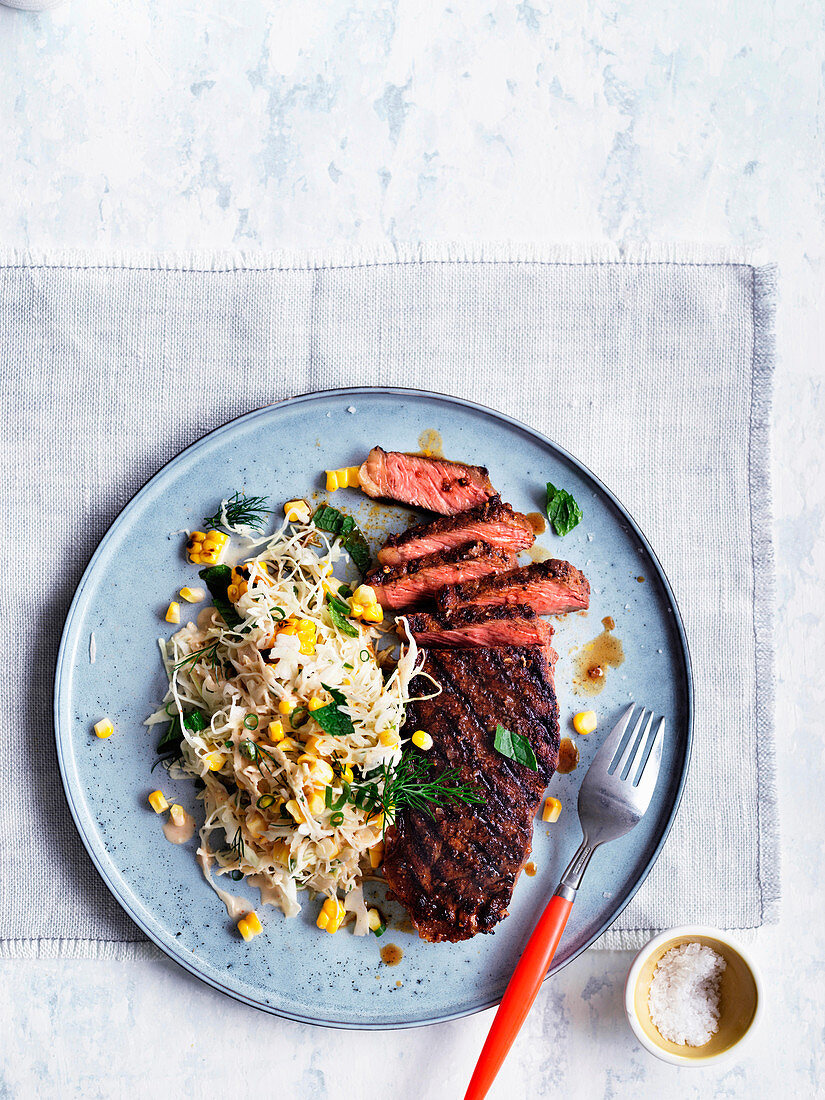 Smoky sirloin steaks with corn and cabbage slaw