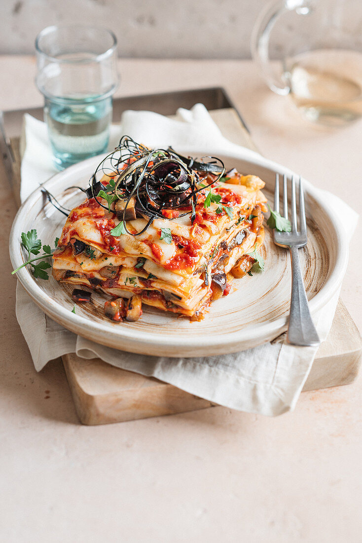 Aubergine lasagne with scamorza and spicy salami