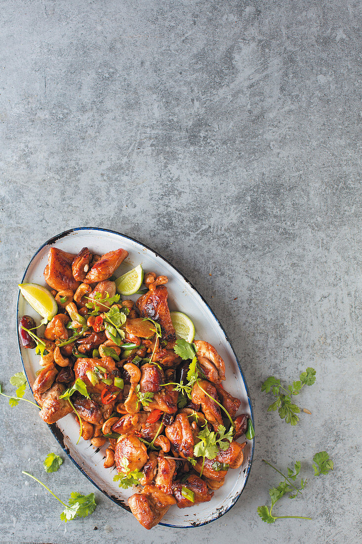 Sherry chicken with coriander leaves and limes