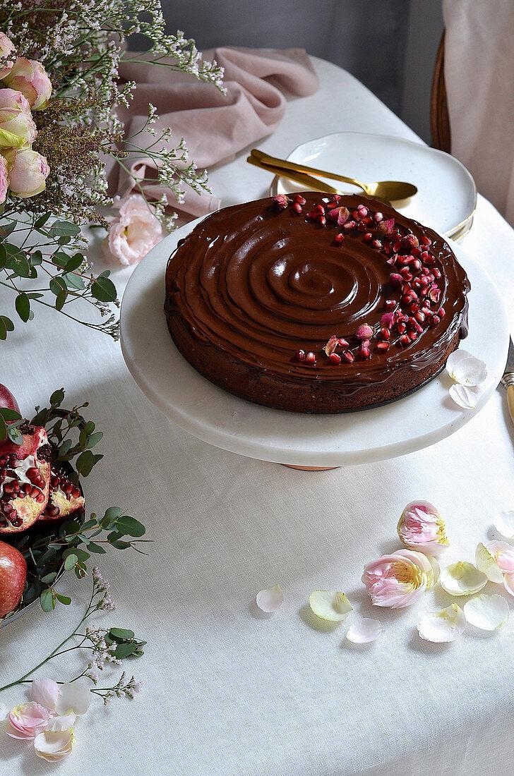 Hazelnut chocolate torte with dark chocolate ganache icing