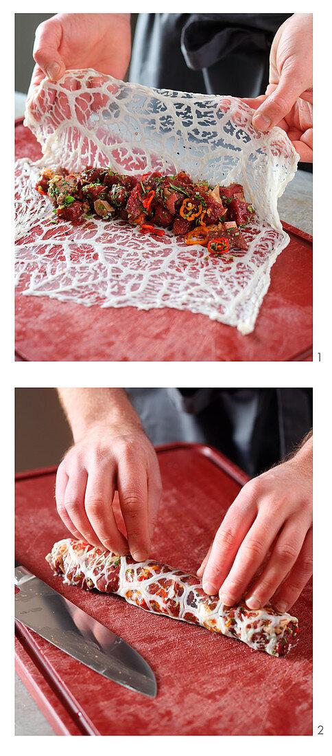 Teriyaki being wrapped in pork mesh
