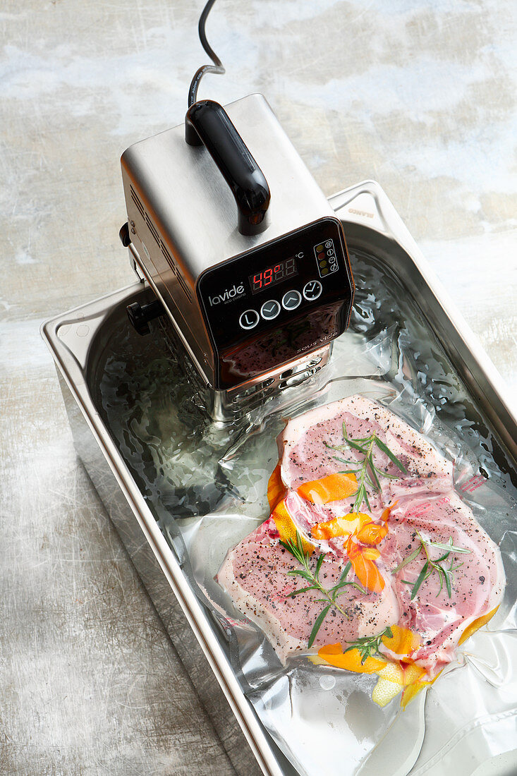 Meat being sous-vided with an immersion thermostat