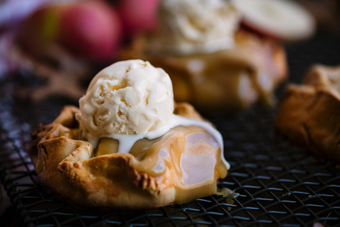 Spelt and apple galettes with butterscotch sauce and vanilla ice cream