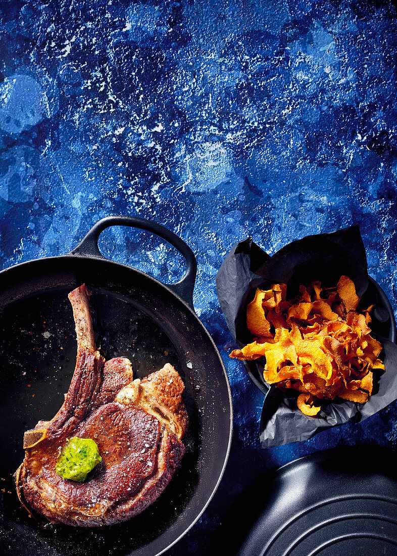 Pan-fried steak with carrot leaf-and-pesto butter and carrot crisps