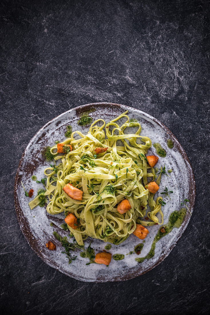 Tagliatelle with herb pesto and diced salmon