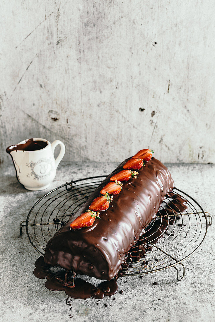Saddle of venison wrapped in marzipan with chocolate glaze and strawberries