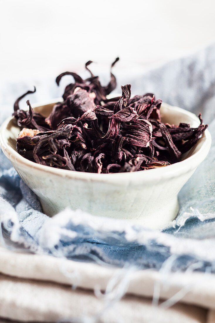 A bowl of hibiscus flower tea