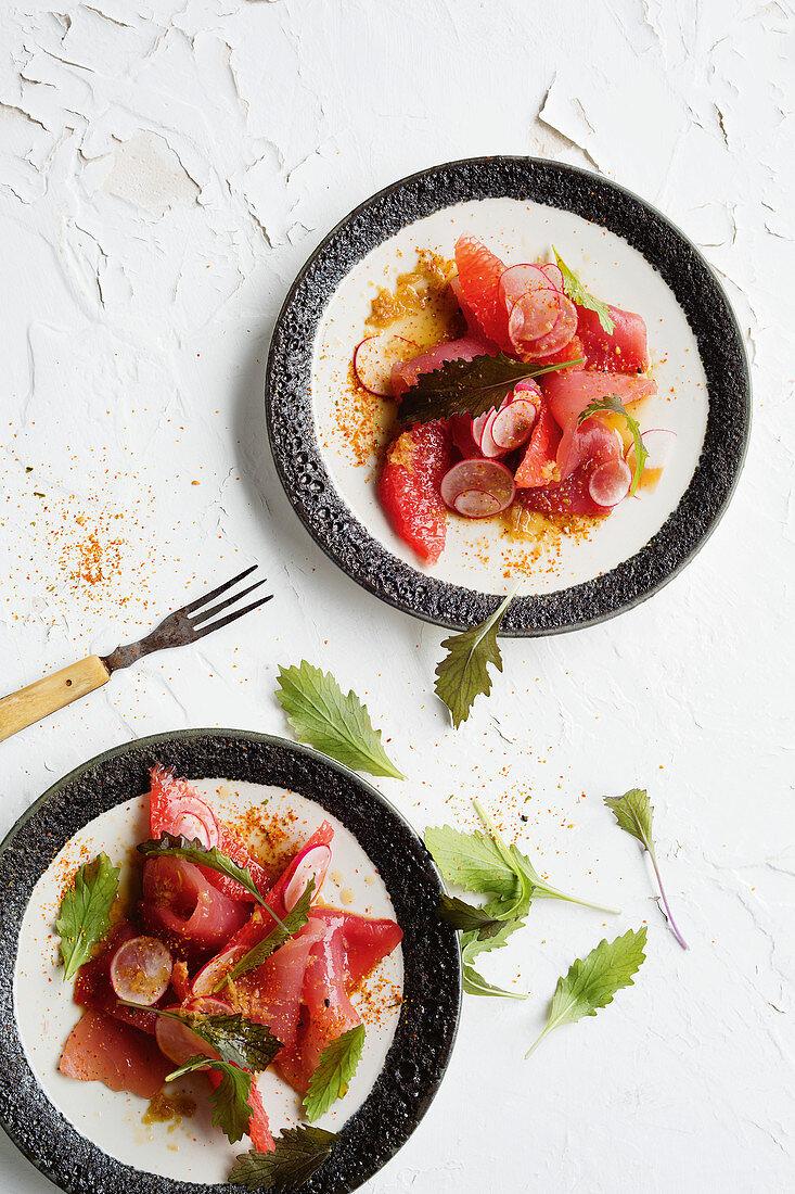 Raw tuna with pink grapefruit and radish