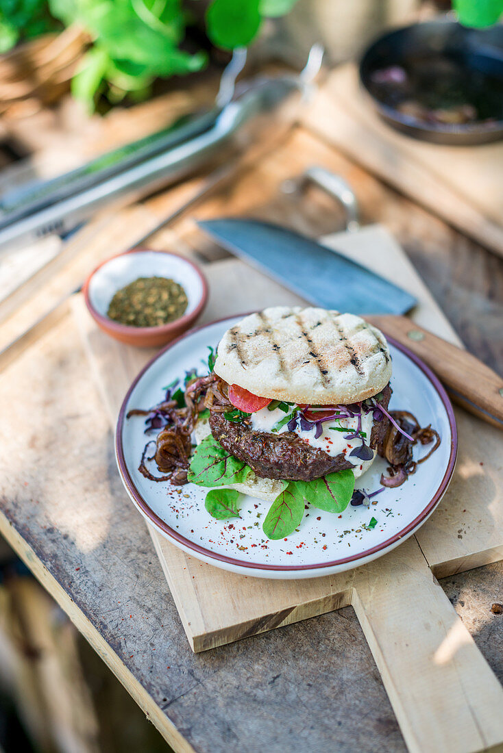Grilled za'atar beef burger on a table outside