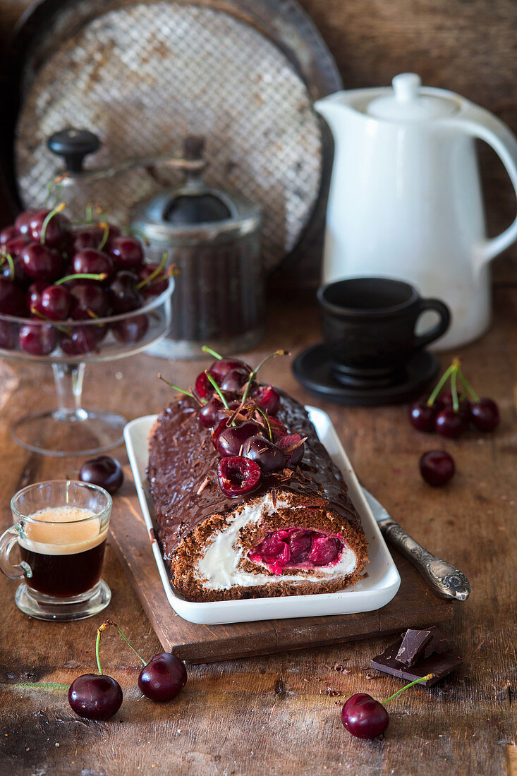 Chocolate biscuit roll with mascarpone cream and cherries
