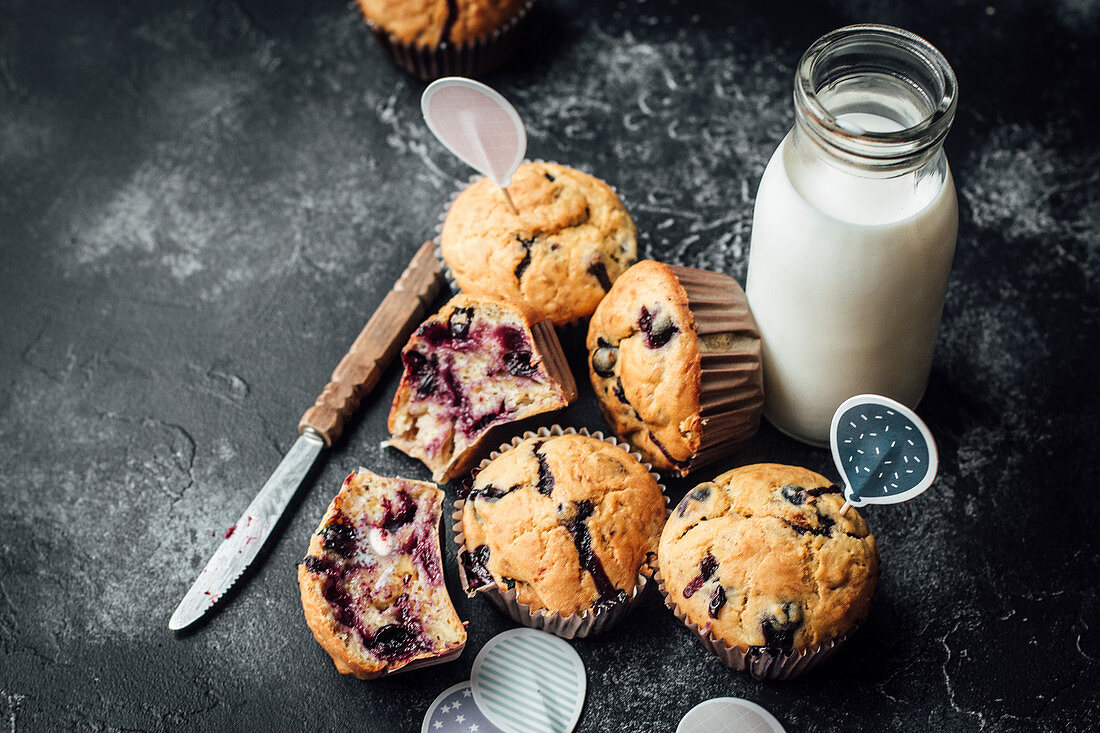 Blueberry muffins and milk in a small bottle