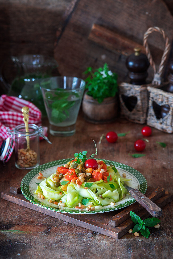 Zucchini noodles with tomatoes and pine nuts