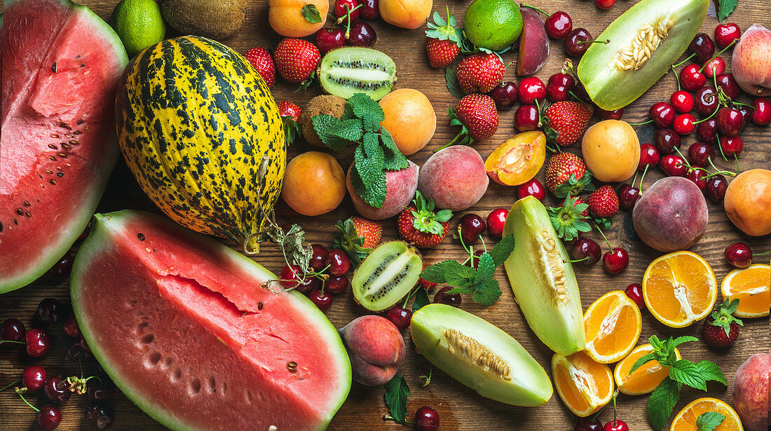 Tropical fruit selection - Watermelon, melon, strawberries, cherries, kiwi, peaches, apricots, oranges and limes