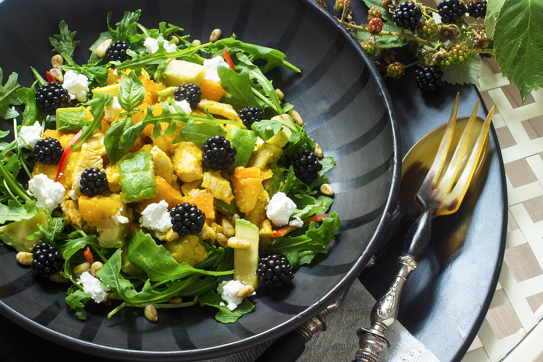 Pumpkin and avocado salad with blackberries and cream cheese
