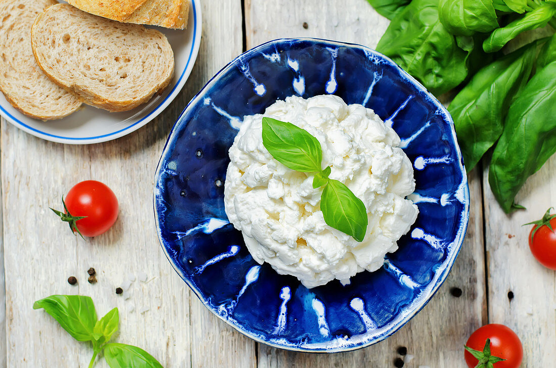 Ricotta cheese with fresh basil and cherry tomatoes