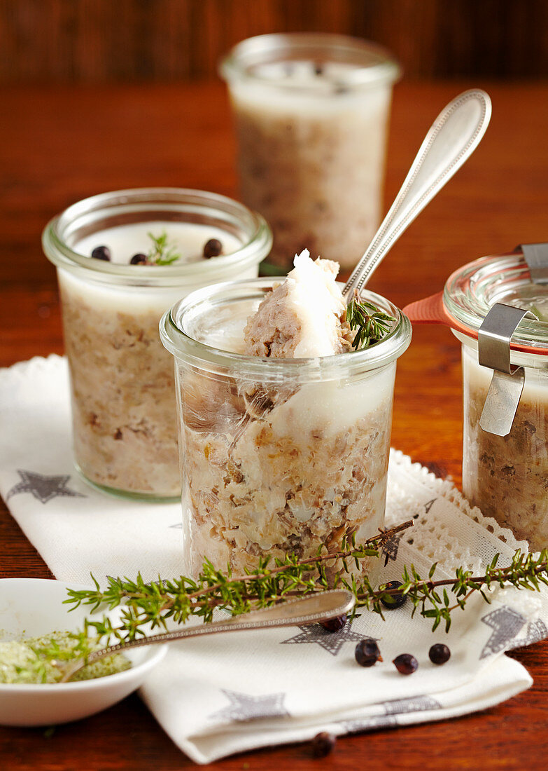 Homemade pork rillette in jars with a silver spoon