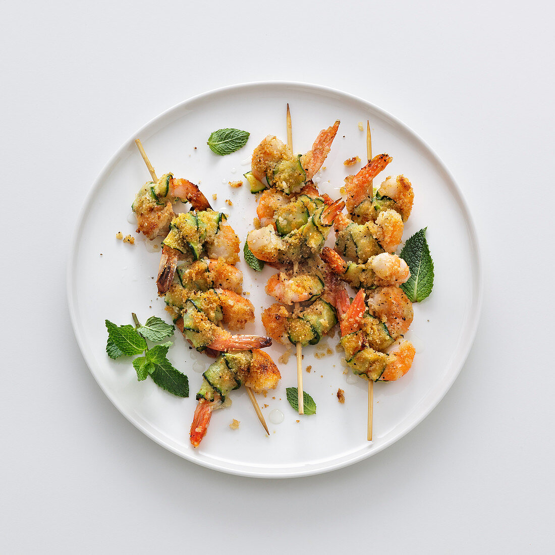 Prawn and courgette skewers with spiced breadcrumbs