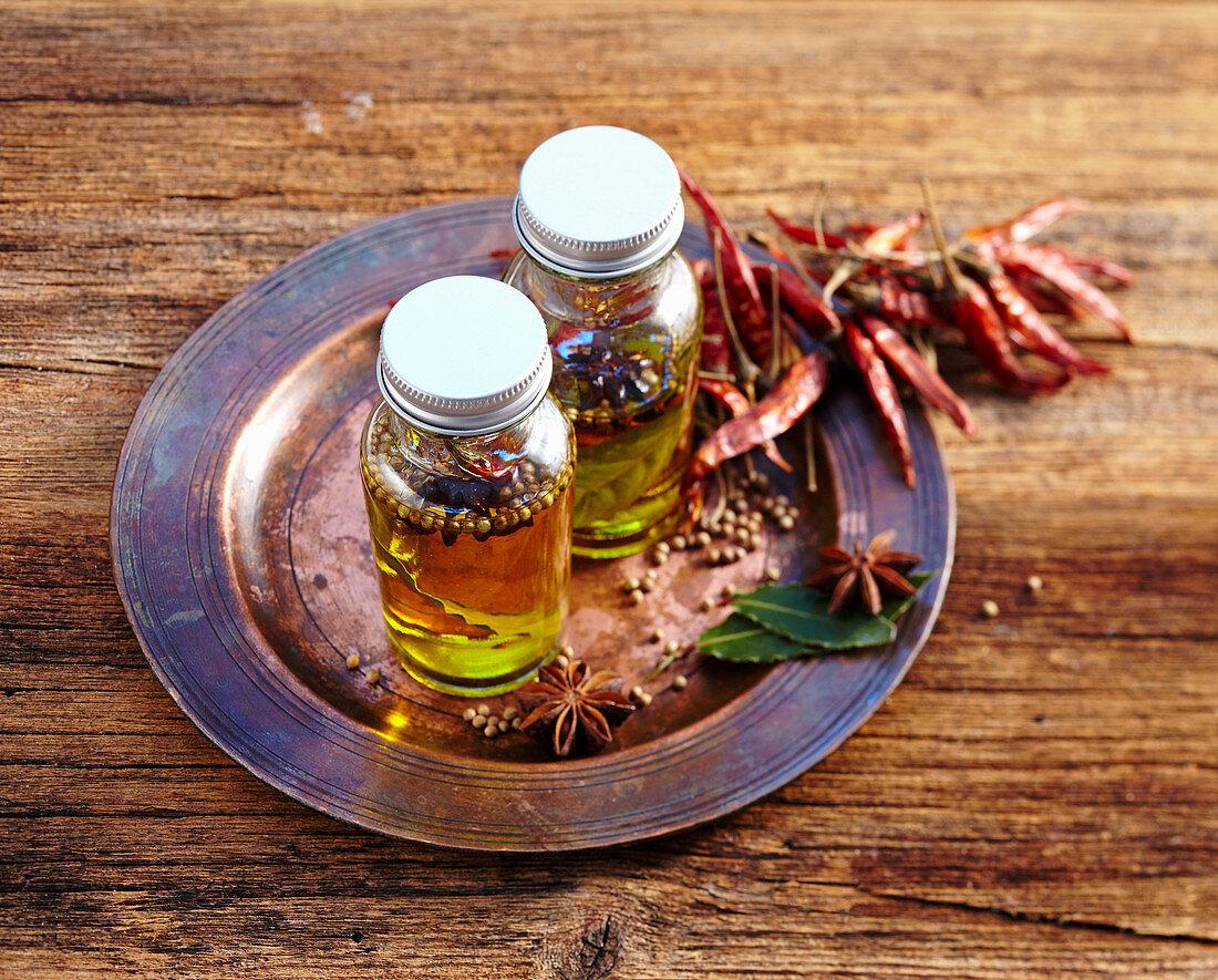Homemade oriental spice oil in small bottles