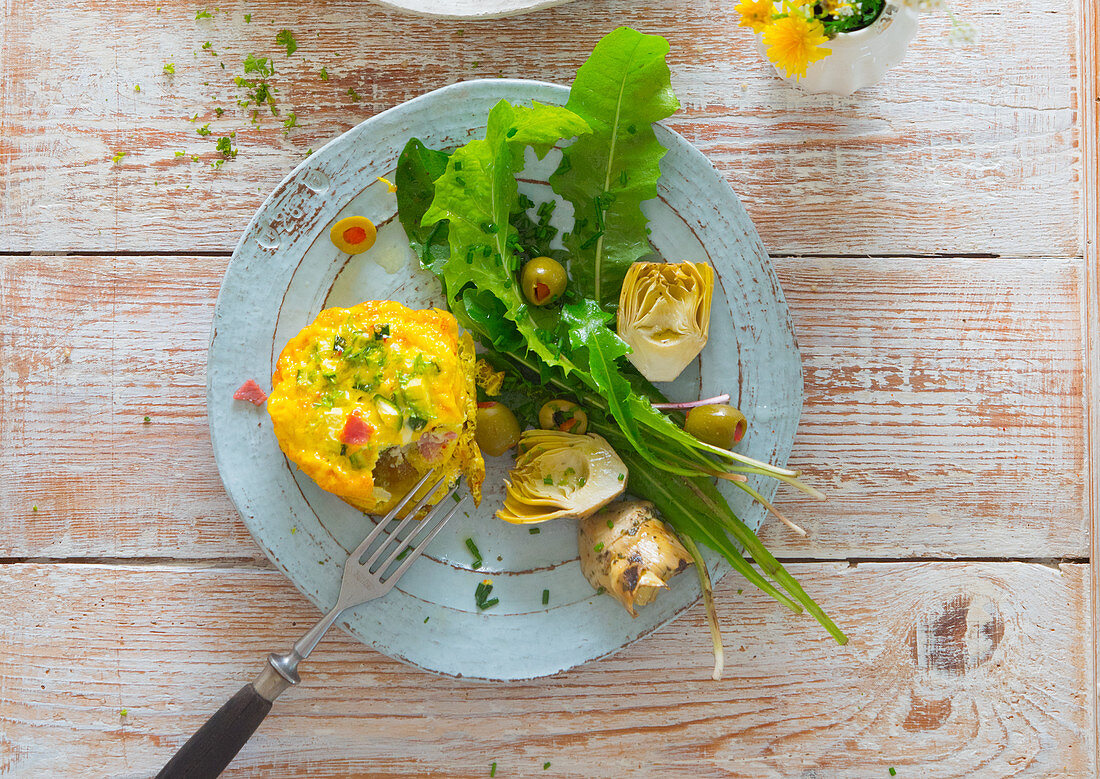 Vegetable quiche with a dandelion and artichoke heart salad