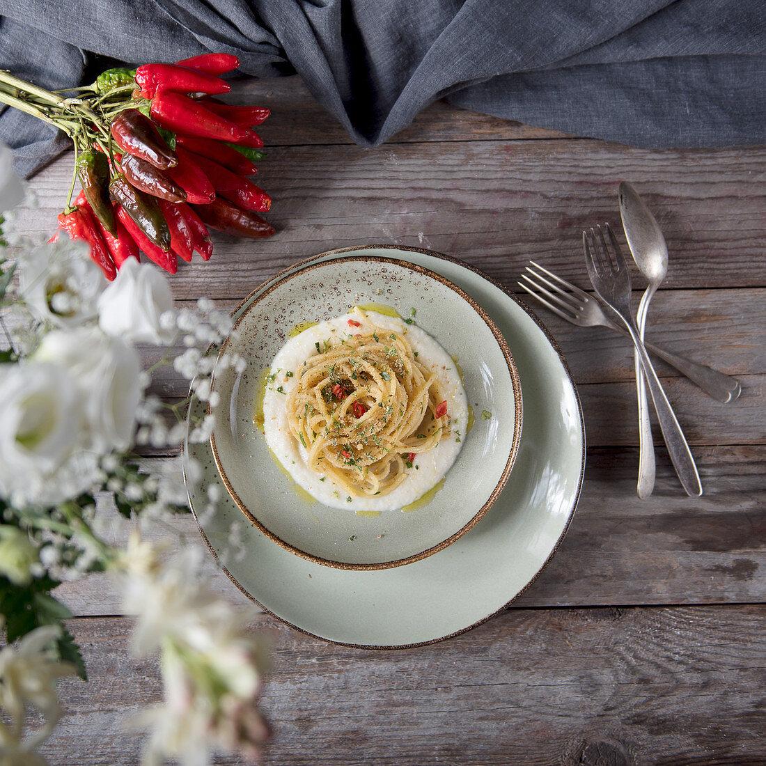 Spaghetti aglio olio e peperoncino on cauliflower foam