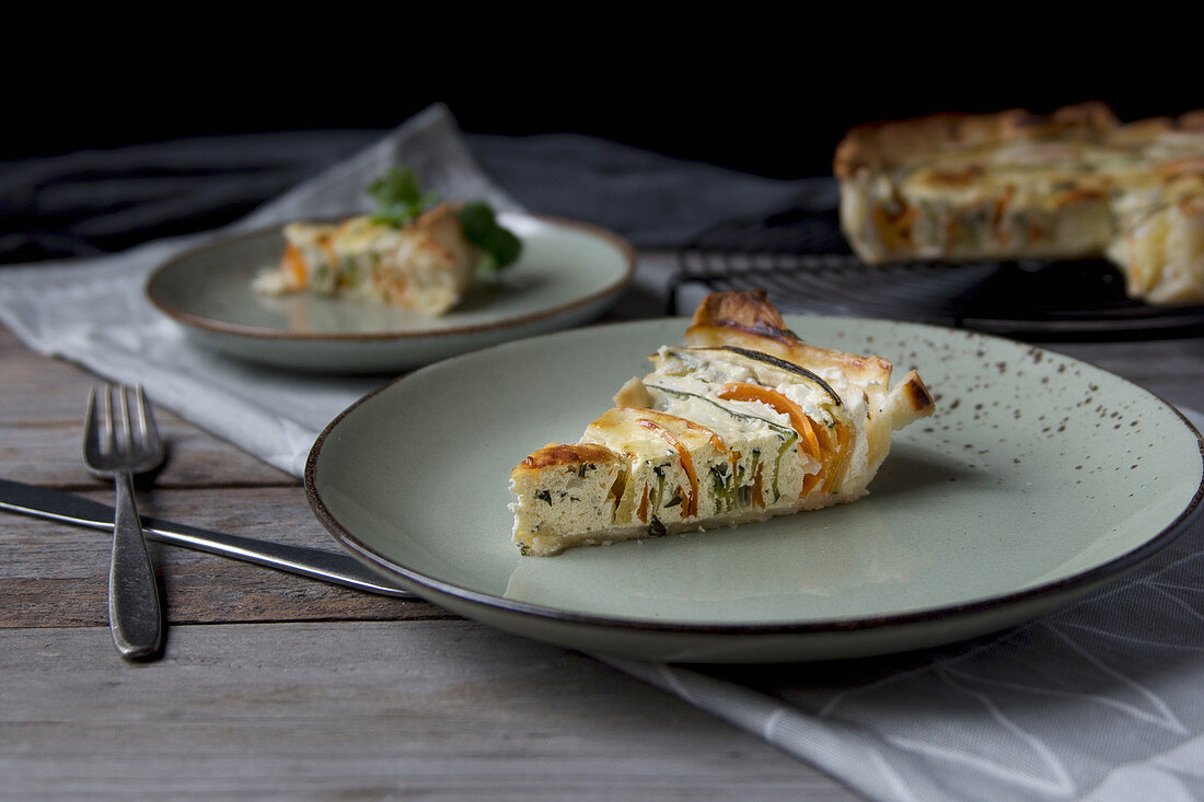 Carrot and courgette quiche, sliced