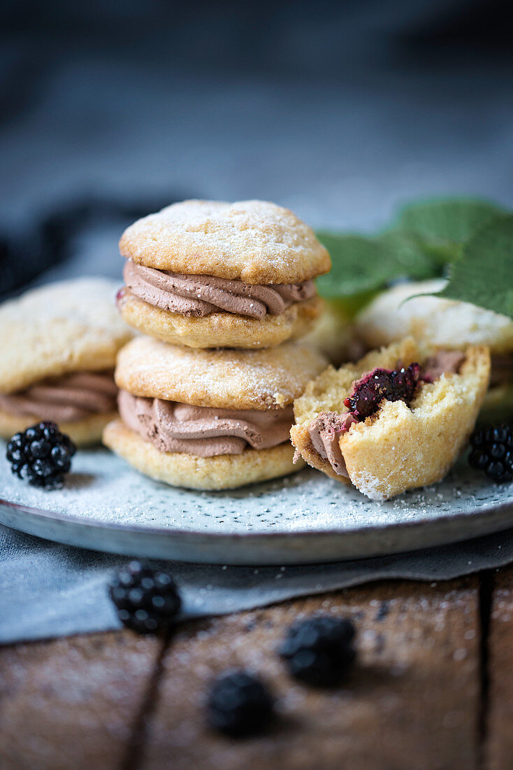 Vegan whoopie pies filled with blackberry sauce and chocolate cream